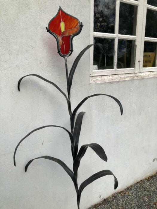 Bladväxt med blomma av glas
